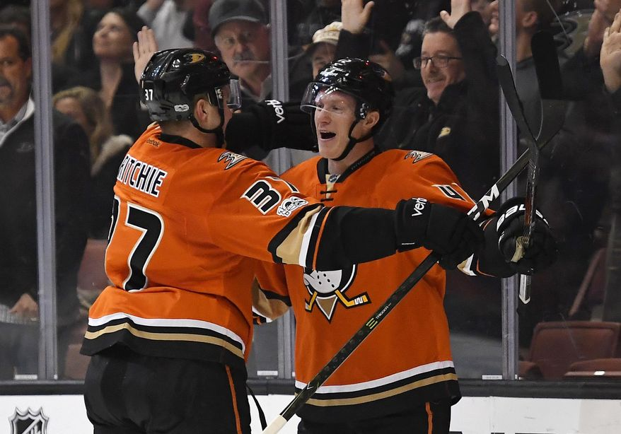Anaheim Ducks defenseman Josh Manson, right, celebrates his goal with left wing Nick Ritchie during the second period of the team's NHL hockey game against the Boston Bruins, Wednesday, Feb. 22, 2017, in Anaheim, Calif. (AP Photo/Mark J. Terrill)
