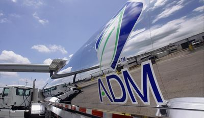 FILE - This July 2, 2009 file photo shows the Archer Daniels Midland Company logo on a tanker truck at the ADM plant in Decatur, Ill. In 2014, Decatur, Illinois, lost Archer Daniels Midland to Chicago after 40 years in the town. Many midsize communities are looking to redefine themselves as more companies trade longtime hometowns for major cities with easier access to global markets and the lifestyle that talented young workers want, with nightlife and public transit.  (AP Photo/Seth Perlman, File)