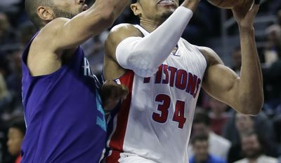 Detroit Pistons forward Tobias Harris (34) is guarded by Charlotte Hornets guard Nicolas Batum (5) while taking a shot during the first half of an NBA basketball game Thursday, Feb. 23, 2017, in Auburn Hills, Mich. (AP Photo/Duane Burleson)