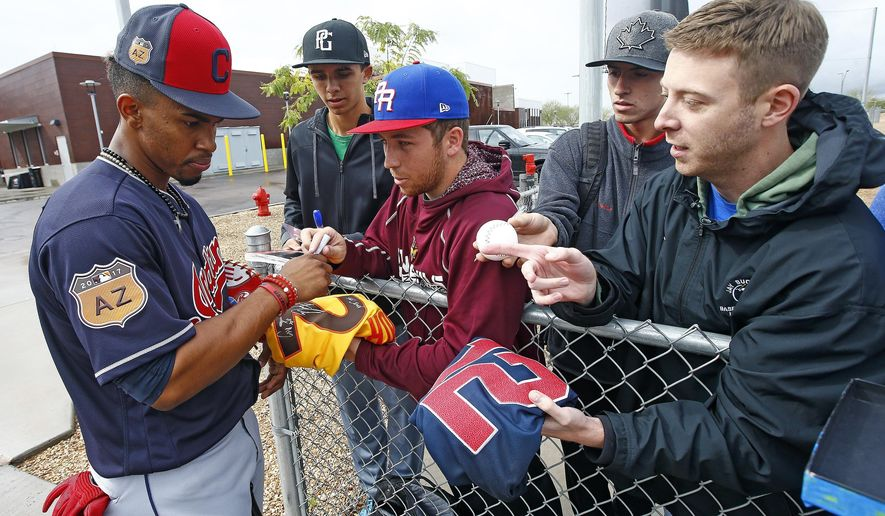 In this Sunday, Feb. 19, 2017 file photo, Cleveland Indians infielder Francisco Lindor signs autographs for fans at the team's baseball spring training facility in Goodyear, Ariz. Lindor, at 23, has blossomed into one of the game's rising young stars. (AP Photo/Ross D. Franklin, File)