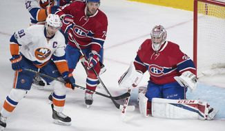 Montreal Canadiens goaltender Carey Price makes a save against New York Islanders' John Tavares (1) as Canadiens' Alexei Emelin (74) defends during the first period of an NHL hockey game Thursday, Feb. 23, 2017, in Montreal. (Graham Hughes/The Canadian Press via AP)
