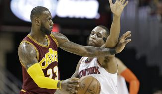 Cleveland Cavaliers' LeBron James, left, passes against New York Knicks' Lance Thomas in the second half of an NBA basketball game, Thursday, Feb. 23, 2017, in Cleveland. The Cavaliers won 119-104.(AP Photo/Tony Dejak)