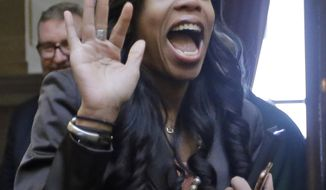 Rep. Mia Love, R-Utah, waves before speaking to the Utah House of Representatives, at the Utah State Capitol Thursday, Feb. 23, 2017, in Salt Lake City. Love says that though she's opposed to abortion, she's running a proposal to make it easier to get birth control pills by allowing women to get it over-the-counter. Love told lawmakers that she feels it's her duty to protect life but it's not her job to tell people how to plan their families. (AP Photo/Rick Bowmer)