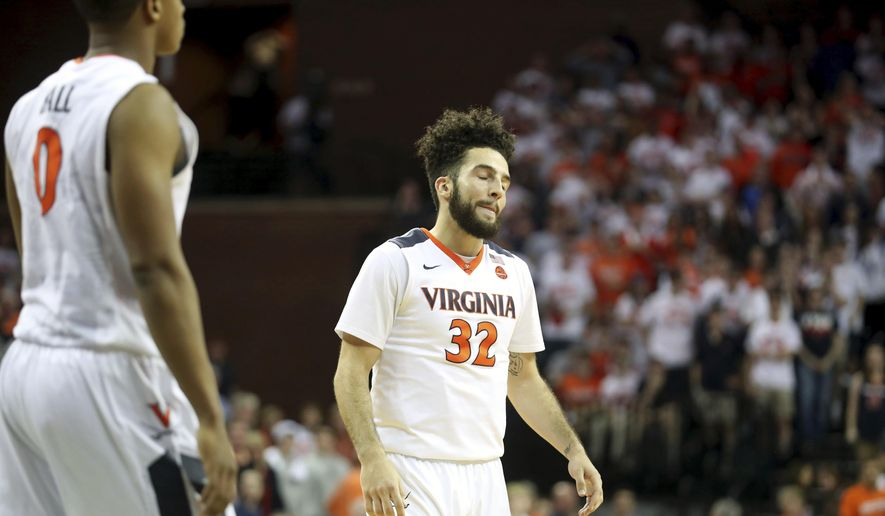 Virginia guard London Perrantes (32) reacts during overtime an NCAA college basketball game against Miami, Monday, Feb. 20, 2017, in Charlottesville, Va. Miami defeated Virginia 54-48. (AP Photo/Ryan M. Kelly) **FILE**