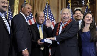 FILE - In this Jan. 5, 2011 file photo, House Speaker John Boehner, second left, of Ohio participates in a ceremonial House swearing-in ceremony for Del. Eni H. Faleomavaega, third from right, D-American Samoa, on Capitol Hill in Washington. American Samoa's longest serving non-voting delegate to the U.S House of Representatives Faleomavaega died Wednesday, Feb. 22, 2017, at age 73. His sister-in-law, Therese Hunkin, didn't disclose the cause of death but said he died at his home in Provo, Utah.  (AP Photo/Susan Walsh, File)