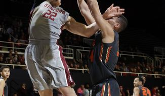 Stanford forward Reid Travis (22) shoots over Oregon State forward Ben Kone during the second half of an NCAA college basketball game Wednesday, Feb. 22, 2017, in Stanford, Calif. (AP Photo/Marcio Jose Sanchez)