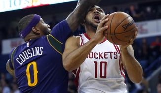 Houston Rockets guard Eric Gordon (10) goes to the basket against New Orleans Pelicans forward DeMarcus Cousins (0) during the first half of an NBA basketball game in New Orleans, Thursday, Feb. 23, 2017. (AP Photo/Gerald Herbert)