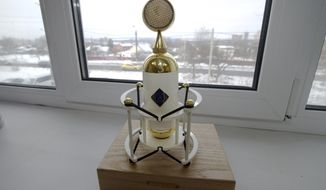 On this Thursday, Feb. 9, 2017 photo a Soyuz SU-017 microphone sits on a window at a factory in Tula, Russia. Californian musician David Brown and fan Pavel Bazdyrev are a rare example of success in Russia's consumer goods industry. They have been making high-end microphones in Russia since 2014, taking advantage of cheap labor and second hand machinery from Kalashnikov arms plants. (AP Photo/Ivan Sekretarev)
