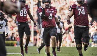 """File-This Nov. 5, 2016, file photo shows South Carolina quarterback Jake Bentley celebrating a touchdown during the first half of an NCAA college football game against Missouri in Columbia, S.C. Bentley's plans for South Carolina are much bigger than rallying the Gamecocks to a bowl. """"I'm thinking to stay here for four years right now,"""" said Bentley, speaking publicly this week for the first time since taking over as the Gamecocks' starting quarterback last October as a freshman. """"I want to win a national championship, and however long that takes I'm going to do it,"""" Bentley continued. """"The young talent that we have is definitely  ready to win a national championship, win an SEC championship.""""(AP Photo/Sean Rayford, File)"""