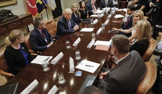President Donald Trump, left, and his daughter Ivanka Trump, right, participate in a meeting on domestic and international human trafficking, Thursday, Feb. 23, 2017,in the Roosevelt Room of the White House in Washington. (AP Photo/Pablo Martinez Monsivais)