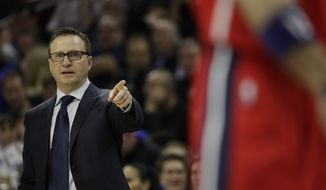 Washington Wizards' Scott Brooks in action during an NBA basketball game against the Philadelphia 76ers, Friday, Feb. 24, 2017, in Philadelphia. (AP Photo/Matt Slocum)