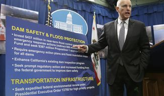 California Gov. Jerry Brown gestures to a chart that show his proposal to spend $437 million on flood control and emergency response in the wake of recent storms, during a news conference Friday, Feb. 24, 2017, in Sacramento, Calif. (AP Photo/Rich Pedroncelli)