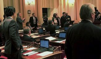 In this image made from a mobile video shows Republican Sen. Janet Nguyen being removed from the Senate floor in Sacramento, Calif., Thursday, Feb. 23, 2017. Nguyen was removed from the state Senate floor after refusing to stop delivering a speech criticizing late state Sen. Tom Hayden for his leadership role in the anti-Vietnam War movement of the 1960s. (AP Photo/Jonathan Cooper)