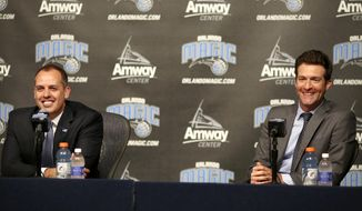 FILE - In this May 23, 2016, file photo, Orlando Magic general manager Rob Hennigan, right, and head coach Frank Vogel address the media in Orlando. Magic president Alex Martins is pleased with Orlando's young core of players and coach Frank Vogel, but is disappointed the team probably won't get to the playoffs for the first time in the post-Dwight Howard era. Martins says the future of the management team, including 34-year-old general manager Rob Hennigan, will be evaluated after the season. (Jacob Langston/Orlando Sentinel via AP, File)