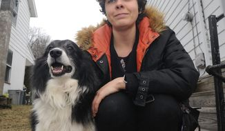ADVANCE FOR SATURDAY FEB 25 AND THEREAFTER - In a Jan. 9, 2017 photo, Hilary Transue, with her dog Buddy. Buddy was adopted by her mother while Hilary was in jail as one of the juveniles imprisoned by Kids for Cash judge Mark Ciavarella. The White Haven native, now 25, graduated in January from Wilkes University with a second master's degree, in fine arts. She was hired recently as an adjunct English professor at Widener University. (Mark Moran/The Times & Tribune via AP)