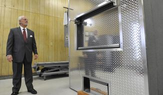 ADVANCE FOR WEEKEND EDITIONS - In this Feb. 15, 2017, photo, Bill Harris, owner of Harris Funeral Home, Inc., looks over the human cremation chamber inside his Laurel Highlands Crematory at his business in Johnstown, Pa. The funeral director has seen an up-turn in overdose deaths in recent years. (Todd Berkey/The Tribune-Democrat via AP)