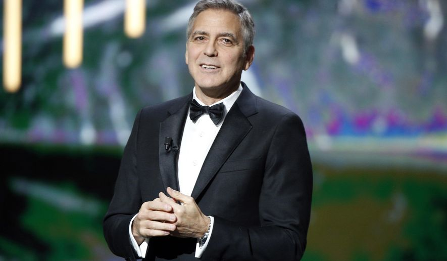 Actor George Clooney reacts on stage as he received an Honorary Cesar award during the 42nd Cesar Film Awards ceremony at Salle Pleyel in Paris, Friday, Feb. 24, 2017. This annual ceremony is presented by the French Academy of Cinema Arts and Techniques. (AP Photo/Thibault Camus)