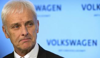 The CEO of Volkswagen Matthias Mueller gestures during a press conference held after the conclusion of the company's board of directors meeting in Wolfsburg, Germany, Friday, Feb. 24, 2017. Volkswagen bounced back into the black in 2016 after suffering a loss the previous year due to the diesel emissions scandal, according to figures released by the German automaker Friday. (Swen Pf'rtner/dpa via AP)