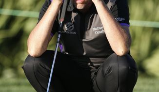 Ian Poulter, of England, lines up a putt on the eighth hole during the first round of the Honda Classic golf tournament, Thursday, Feb. 23, 2017, in Palm Beach Gardens, Fla. (AP Photo/Wilfredo Lee)