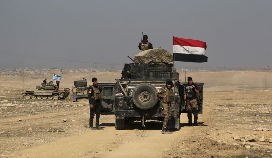 Iraqi special forces advance towards the western side of Mosul, Iraq, Thursday, Feb. 23, 2017. The advance comes as part of a major assault that started five days earlier to drive Islamic State militants from the western half of Mosul, Iraq's second-largest city. (AP Photo/ Khalid Mohammed)