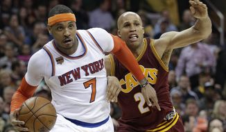 New York Knicks' Carmelo Anthony (7) drives against Cleveland Cavaliers' Richard Jefferson (24) in the second half of an NBA basketball game, Thursday, Feb. 23, 2017, in Cleveland. The Cavaliers won 119-104. (AP Photo/Tony Dejak)