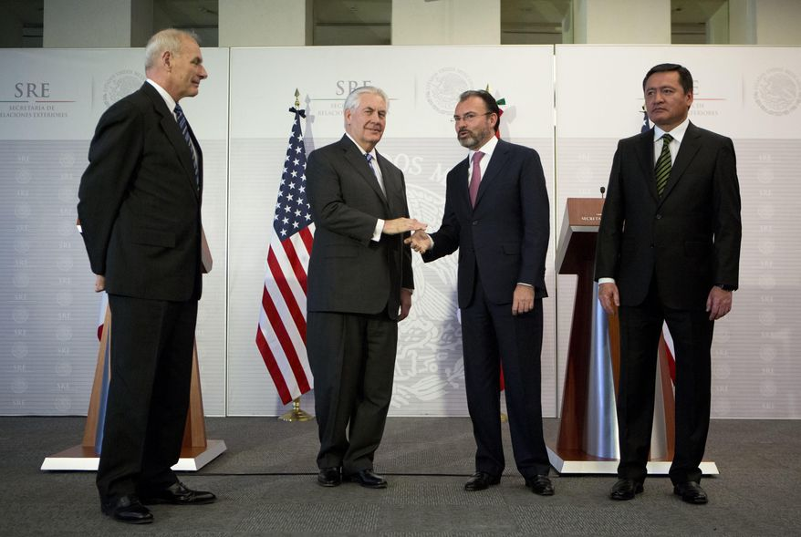 U.S. Secretary of State Rex Tillerson, center left, shakes hands with Mexico's Foreign Relations Secretary Luis Videgaray as U.S. Homeland Security Secretary John Kelly, left, and Mexico's Interior Secretary Miguel Angel Osorio Chong look on, at the Foreign Affairs Ministry in Mexico City, Thursday, Feb. 23, 2017. Mexico's mounting unease and resentment over President Donald Trump's immigration crackdown are looming over a Thursday meeting between Tillerson, Homeland Security Secretary John Kelly, and Mexican leaders that the U.S. had hoped would project a strong future for relations between neighbors. (AP Photo/Rebecca Blackwell)