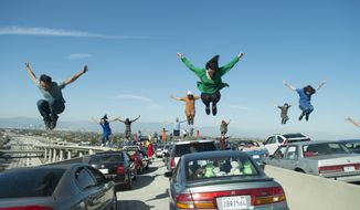 "This image released by Lionsgate shows a dance scene from the Oscar-nominated film, ""La La Land."" It's not easy to stage a successful dance scene for the cameras, especially on a highway interchange, but when such a scene works, it can be memorable.  (Dale Robinette/Lionsgate via AP)"