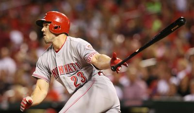 FILE - In this Sept. 26, 2016, file photo, Cincinnati Reds' Adam Duvall hits a three-run home run in the fifth inning of a baseball game against the St. Louis Cardinals, in St. Louis.  Duvall is hard at work in the Arizona desert, looking for an encore to his breakout season for the Reds.  (Chris Lee/St. Louis Post-Dispatch via AP, File)