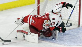 Carolina Hurricanes goalie Eddie Lack (31) blocks while Ottawa Senators' Chris Kelly (22) crashes into the goal during the third period of an NHL hockey game in Raleigh, N.C., Friday, Feb. 24, 2017. Carolina won 3-0. (AP Photo/Gerry Broome)