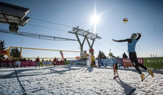 In this March 2016 photo released by Chaka2 GmbH, Austria's Michael Leeb, serving, and Florian Schnetzer face off against Poland's Michal Matyja and Rafal Matusiak, far court, during a snow volleyball match in Wagrain-Kleinarl, Austria. The sport's international governing body hopes tournaments from the Alps to the Andes will earn snow volleyball a spot in the Olympics and make volleyball the first sport to be played in both the Winter and Summer Games. (Thomas Leskoschek/Chaka2 GmbH via AP)
