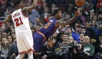 Phoenix Suns' Marquese Chriss (0) shoots after being fouled by Chicago Bulls' Jimmy Butler during the first half of an NBA basketball game Friday, Feb. 24, 2017, in Chicago. (AP Photo/Charles Rex Arbogast)