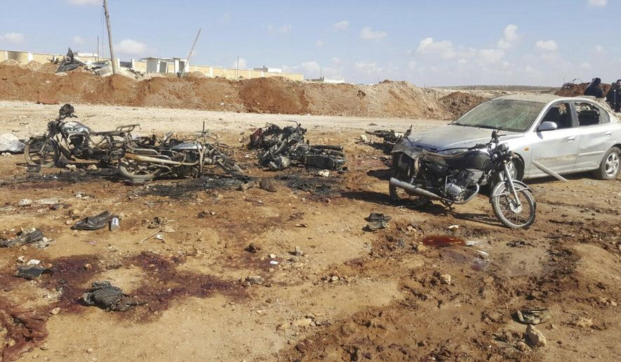 This image released by the Thiqa News Agency, burned motorcycles and car that damaged after a suicide attacker blew his small pick-up truck outside a security office in Sousian village, about 8 kilometers (5 miles) north of al-Bab, Syria, Friday, Feb. 24, 2017. A car bombing north of a Syrian town just captured by Turkish forces and Syrian opposition fighters from the Islamic State group killed several people, mostly civilians who had gathered trying to go back home, Turkey's news agency and Syrian activists said. (Thiqa News Agency, via AP) **FILE**