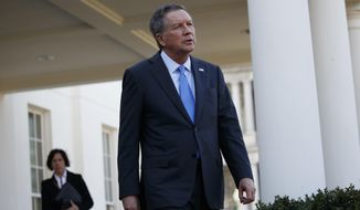 Ohio Gov. John Kasich walks out of the White House in Washington, Friday, Feb. 24, 2017, to speak with reporters following a meeting with President Donald Trump. (AP Photo/Evan Vucci)