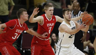 Colorado forward Lucas Siewert, right, juggles the ball while fielding a pass in front of Utah forwards Tyler Rawson, center, and Jayce Johnson during the first half of an NCAA college basketball game Thursday, Feb. 23, 2017, in Boulder, Colo. (AP Photo/David Zalubowski)