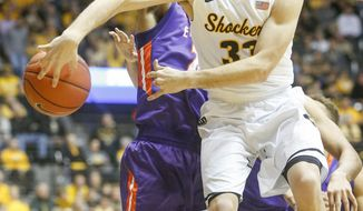 FILE - In this Feb. 21, 2017, file photo, Wichita State guard Conner Frankamp passes the ball against Evansville during the first half of an NCAA college basketball game in Wichita, Kan. Few blueblood programs can send two players to the NBA and maintain its dominance, yet that's exacty what mid-major powerhouse Wichita State has done. Quietly under the radar all year, the Shockers are, well, shocking once again.  (Fernando Salazar/The Wichita Eagle via AP, File)
