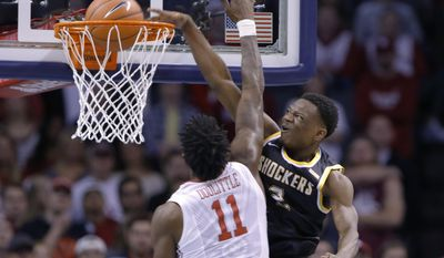 FILE - In this Dec. 10, 2016, file photo, Wichita State guard Daishon Smith (2) dunks against Oklahoma forward Kristian Doolittle (11) during the second half of an NCAA college basketball game in Oklahoma City. Few blueblood programs can send two players to the NBA and maintain its dominance, yet that's exacty what mid-major powerhouse Wichita State has done. Quietly under the radar all year, the Shockers are, well, shocking once again.  (AP Photo/Alonzo Adams, File)