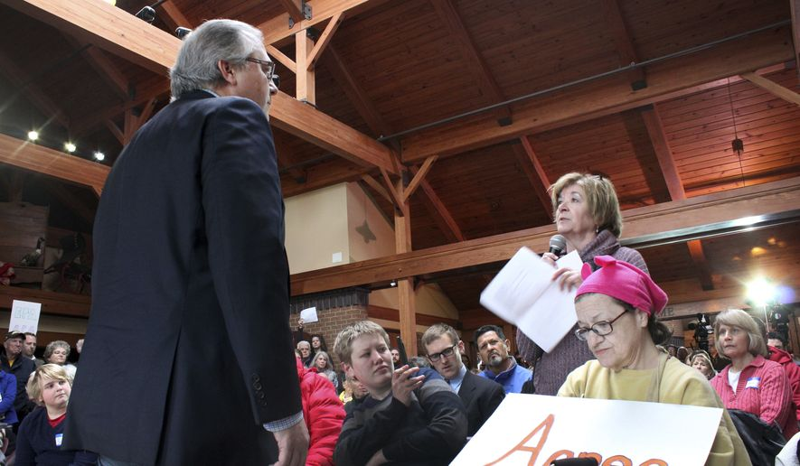 "In this Feb. 23, 2017, file photo, Rep. David Young, R-Iowa, left, talks with Kay Marcel, of Urbandale, Iowa, during a town hall meeting in Urbandale, Iowa. A week of protests and raucous town halls isn't deterring President Donald Trump or the Republican congressional leadership. They're ""staying the course"" on health care, taxes and other issues. But the national pushback leaves some Republicans wary, not only about the next steps on the agenda but the possibility it could prove costly in next year's elections. (AP Photo/Linley Sanders)"
