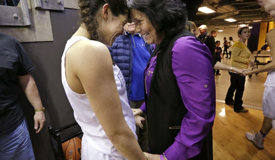 Washington's Kelsey Plum, left, is greeted by her mother, Katie Plum, after the team's NCAA college basketball game against Utah on Saturday, Feb. 25, 2017, in Seattle. Plum scored 57 points and set the all-time career NCAA scoring record at 3,397 points during the game. Washington won 84-77. (AP Photo/Elaine Thompson)