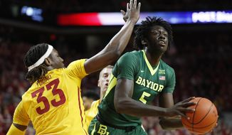Baylor forward Johnathan Motley drives to the basket past Iowa State forward Solomon Young, left, during the first half of an NCAA college basketball game, Saturday, Feb. 25, 2017, in Ames, Iowa. (AP Photo/Charlie Neibergall)