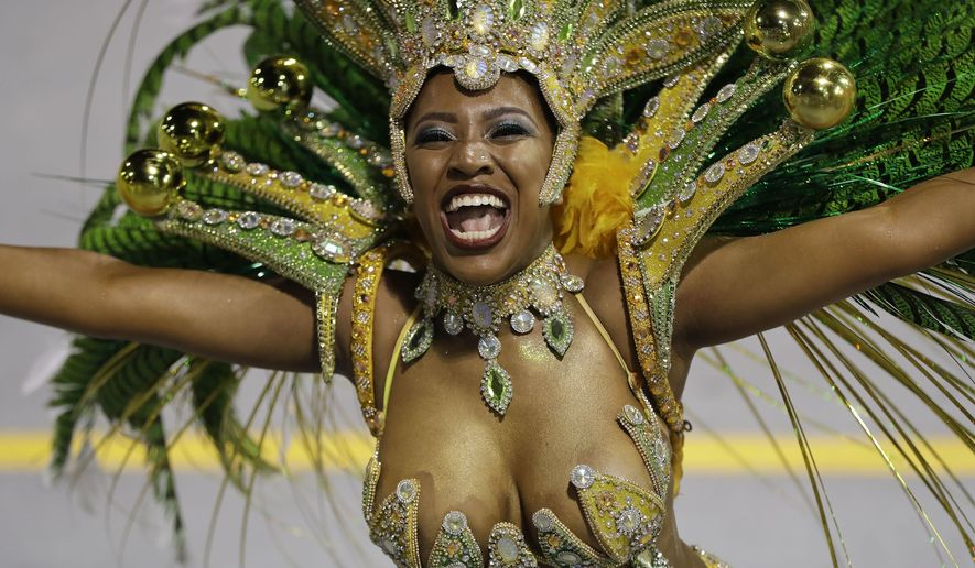 A dancer from the Tom Maior samba school performs during a carnival parade in Sao Paulo, Brazil, Friday, Feb. 24, 2017. (AP Photo/Andre Penner)