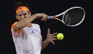 Austria's Dominic Thiem returns the ball to Spain's Albert Ramos-Vinolas at the semi-finals of the Rio Open tennis tournament in Rio de Janeiro, Brazil, Saturday, Feb. 25, 2017. (AP Photo/Felipe Dana)