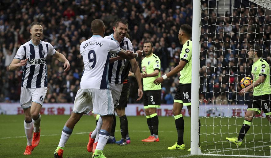 West Bromwich Albion's Gareth McAuley, centre right, celebrates scoring his side's second goal of the game during the English Premier League soccer match between West Bromwich Albion and AFC Bournemouth at the Hawthorns in West Bromwich, England. Saturday, Feb. 25, 2017 (Nick Potts/PA via AP)