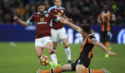 Burnley's George Boyd, left, and Hull City's Harry Maguire battle for the ball during the English Premier League soccer match between Hull and Burnley at the KCOM stadium, Hull, England. Saturday, Feb. 25, 2017 (Mike Egerton/PA via AP)