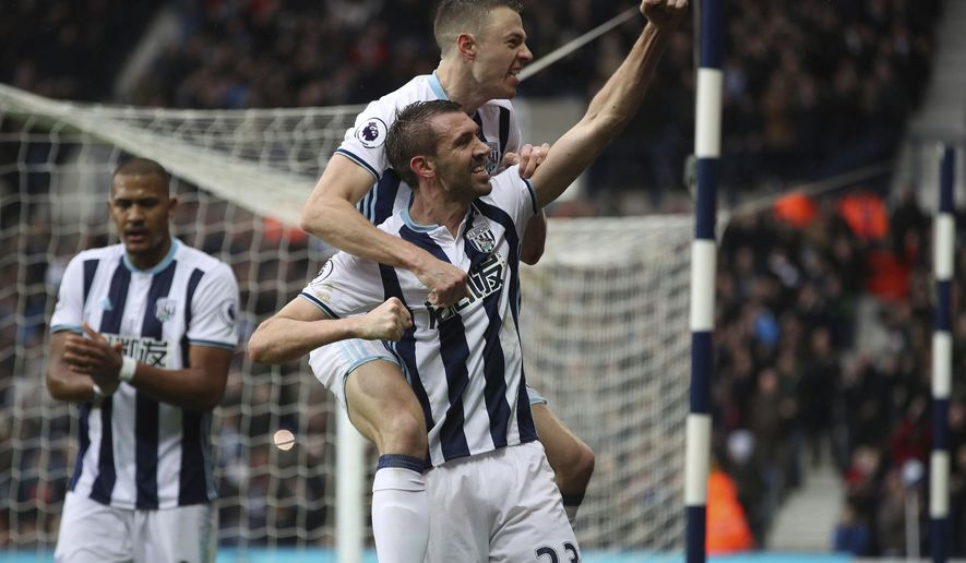 West Bromwich Albion's Gareth McAuley celebrates scoring his side's second goal of the game during the English Premier League soccer match between West Bromwich and AFC Bournemouth at The Hawthorns, West Bromwich, England, Saturday, Feb. 25, 2017.  (Nick Potts/PA via AP)