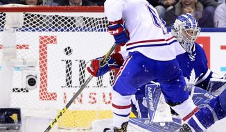 Montreal Canadiens' Andrew Shaw (65) scores the game-winning overtime goal against Maple Leafs goalie Frederik Andersen (31) during an NHL hockey game, in Toronto on Saturday, Feb. 25, 2017. (Frank Gunn/The Canadian Press via AP)