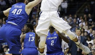 Villanova's Josh Hart (3) is fouled by Creighton's Zach Hanson (40) during the first half of an NCAA college basketball game, Saturday, Feb. 25, 2017, in Villanova, Pa. (AP Photo/Matt Slocum)
