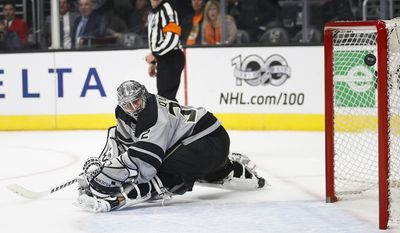 The puck hit by Anaheim Ducks' Andrew Cogliano enters the net past Los Angeles Kings goalie Jonathan Quick for a goal during the first period of an NHL hockey game Saturday, Feb. 25, 2017, in Los Angeles.(AP Photo/Jae C. Hong)
