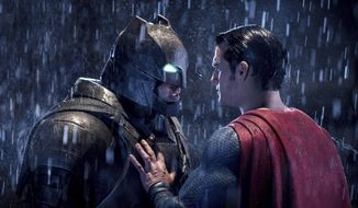 "Ben Affleck, left, and Henry Cavill in a scene from, ""Batman v Superman: Dawn of Justice."" (Clay Enos/Warner Bros. Pictures via AP) ** FILE **"