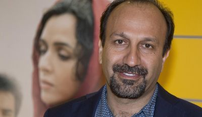 """FILE - In this Oct. 10, 2016 file photo, Iranian director Asghar Farhadi poses for a photo during the premiere of his film, """"The Salesman, in Paris.  The Oscar-nominated Iranian film director has sent a video message to a rally attended by celebrities and top talent agents to thank the Hollywood community for its support during his boycott of the awards ceremony. Last month, after U.S. President Donald Trump issued an executive order temporarily banning immigrants from seven Muslim majority countries, including Iran, Asghar Farhadi decided to boycott the Oscars. (AP Photo/Michel Euler, File)"""