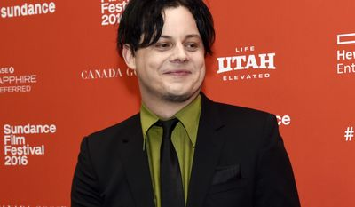 "FILE - This Jan. 28, 2016 file photo shows musician Jack White, an executive producer of ""American Epic,"" at the premiere of the four-part PBS music documentary series at the 2016 Sundance Film Festival in Park City, Utah. White returns to his hometown of Detroit this weekend for the opening of a vinyl record pressing plant at his Third Man Records store, which he opened two years ago in a neighborhood that has been undergoing a revitalization since the city emerged from bankruptcy. (Photo by Chris Pizzello/Invision/AP, File)"